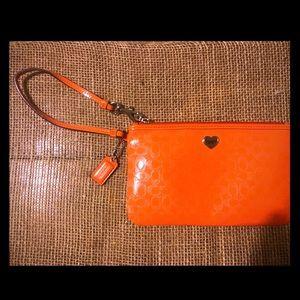 Orange Embossed Large Coach Single Zip Wrislet